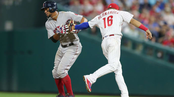 PHILADELPHIA, PA - AUGUST 14: Cesar Hernandez #16 of the Philadelphia Phillies tags out Xander Bogaerts #2 of the Boston Red Sox on a fielders choice in the ninth inning during a game at Citizens Bank Park on August 14, 2018 in Philadelphia, Pennsylvania. The Red Sox won 2-1. (Photo by Hunter Martin/Getty Images)