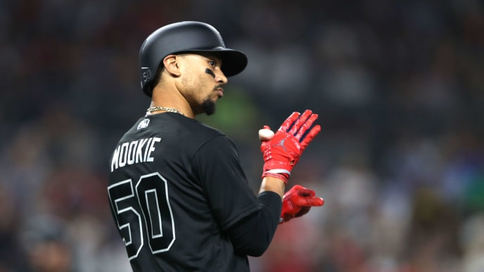 SAN DIEGO, CALIFORNIA - AUGUST 23:  Mookie Betts #50 of the Boston Red Sox reacts after hitting an RBI sacrifice fly during the second inning of a game against the San Diego Padres at PETCO Park on August 23, 2019 in San Diego, California.  Teams are wearing special color schemed uniforms with players choosing nicknames to display for Players' Weekend. (Photo by Sean M. Haffey/Getty Images)