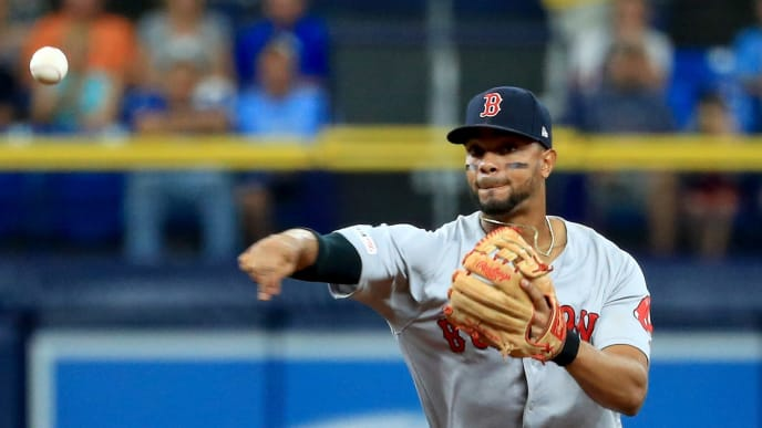 ST PETERSBURG, FLORIDA - JULY 24: Xander Bogaerts #2 of the Boston Red Sox makes a throw to first in the second inning during a game against the Tampa Bay Rays at Tropicana Field on July 24, 2019 in St Petersburg, Florida. (Photo by Mike Ehrmann/Getty Images)