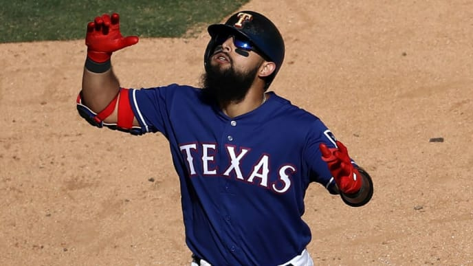 ARLINGTON, TEXAS - SEPTEMBER 26:  Rougned Odor #12 of the Texas Rangers celebrates a homerun in the seventh inning against the Boston Red Sox at Globe Life Park in Arlington on September 26, 2019 in Arlington, Texas. (Photo by Ronald Martinez/Getty Images)