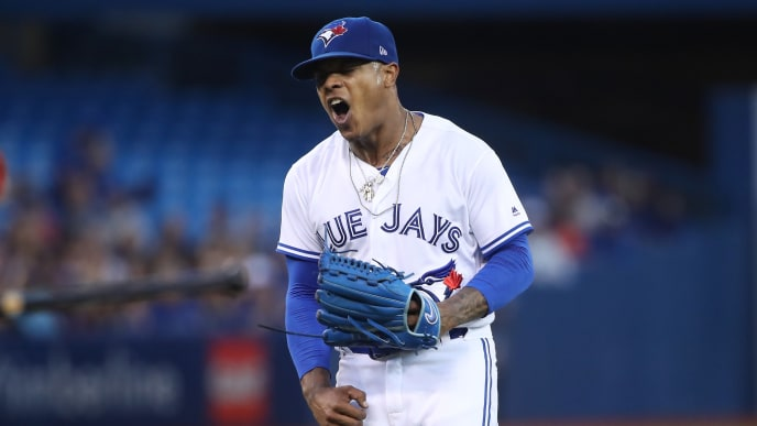 TORONTO, ON - AUGUST 28: Marcus Stroman #6 of the Toronto Blue Jays reacts after a throwing error by Raffy Lopez #1 allowed an unearned run in the second inning during MLB game action against the Boston Red Sox at Rogers Centre on August 28, 2017 in Toronto, Canada. (Photo by Tom Szczerbowski/Getty Images)