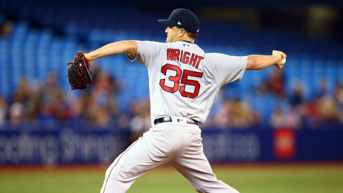 TORONTO, ON - JULY 03:  Steven Wright #35 of the Boston Red Sox delivers a pitch in the eighth inning during a MLB game against the Toronto Blue Jays at Rogers Centre on July 03, 2019 in Toronto, Canada.  (Photo by Vaughn Ridley/Getty Images)