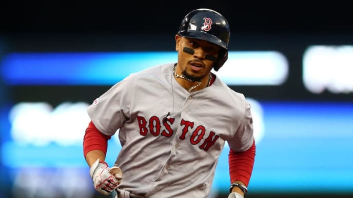TORONTO, ON - SEPTEMBER 10:  Mookie Betts #50 of the Boston Red Sox rounds third base after hitting a home run in the first inning during a MLB game against the Toronto Blue Jays at Rogers Centre on September 10, 2019 in Toronto, Canada.  (Photo by Vaughn Ridley/Getty Images)