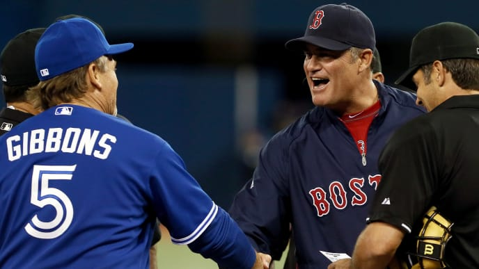 TORONTO, CANADA - APRIL 5: Manager John Farrell of the Boston Red Sox takes to the field against John Gibbons of the Toronto Blue Jays during MLB action at the Rogers Centre April 5, 2013 in Toronto, Ontario, Canada. (Photo by Abelimages/Getty Images)