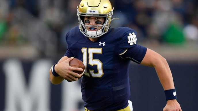 SOUTH BEND, INDIANA - OCTOBER 05: Phil Jurkovec #15 of the Notre Dame Fighting Irish runs with the football in the second half against the Bowling Green Falcons at Notre Dame Stadium on October 05, 2019 in South Bend, Indiana. (Photo by Quinn Harris/Getty Images)