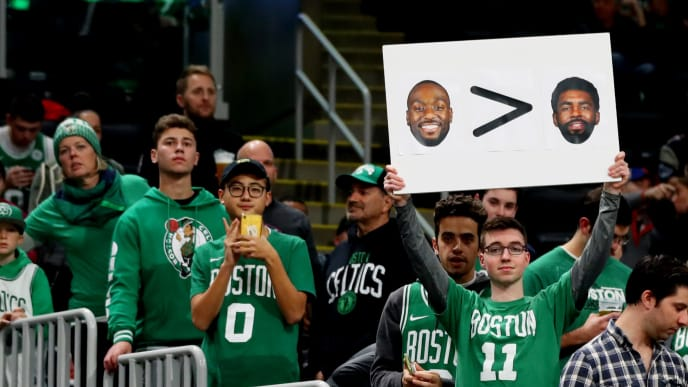 BOSTON, MASSACHUSETTS - NOVEMBER 27: A fan holds a sign with photos of Kyrie Irving and Kemba Walker before the game between the Boston Celtics and the Brooklyn Nets at TD Garden on November 27, 2019 in Boston, Massachusetts. (Photo by Maddie Meyer/Getty Images)