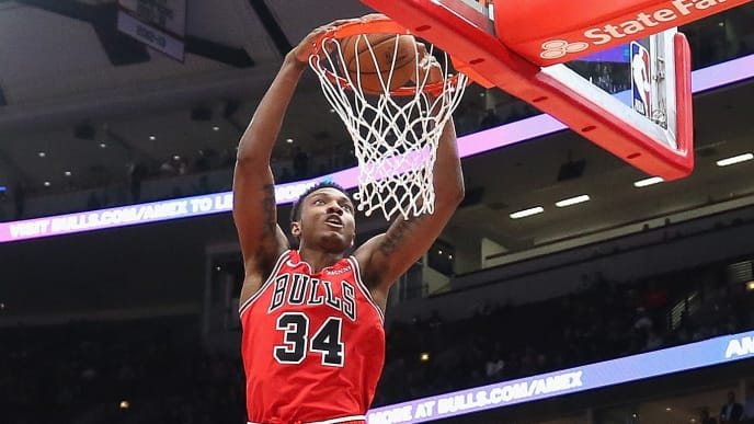 CHICAGO, ILLINOIS - DECEMBER 19: Wendell Carter Jr. #34 of the Chicago Bulls dunks over Rondae Hollis-Jefferson #24 of the Brooklyn Nets at the United Center on December 19, 2018 in Chicago, Illinois. NOTE TO USER: User expressly acknowledges and agrees that, by downloading and or using this photograph, User is consenting to the terms and conditions of the Getty Images License Agreement. (Photo by Jonathan Daniel/Getty Images)
