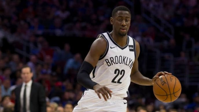 PHILADELPHIA, PA - APRIL 23: Caris LeVert #22 of the Brooklyn Nets dribbles the ball against the Philadelphia 76ers in Game Five of Round One of the 2019 NBA Playoffs at the Wells Fargo Center on April 23, 2019 in Philadelphia, Pennsylvania. NOTE TO USER: User expressly acknowledges and agrees that, by downloading and or using this photograph, User is consenting to the terms and conditions of the Getty Images License Agreement. (Photo by Mitchell Leff/Getty Images)