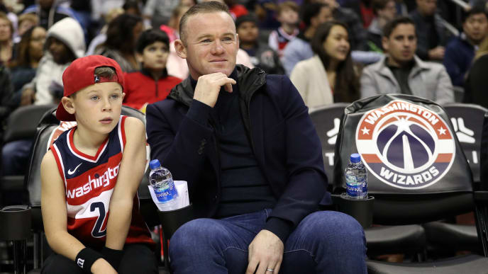WASHINGTON, DC - DECEMBER 01:  DC United soccer player, and former Manchester United player, Wayne Rooney looks on from a court side seat with his son as the Brooklyn Nets play the Washington Wizards during the first half at Capital One Arena on December 01, 2018 in Washington, DC. NOTE TO USER: User expressly acknowledges and agrees that, by downloading and or using this photograph, User is consenting to the terms and conditions of the Getty Images License Agreement. (Photo by Patrick Smith/Getty Images)