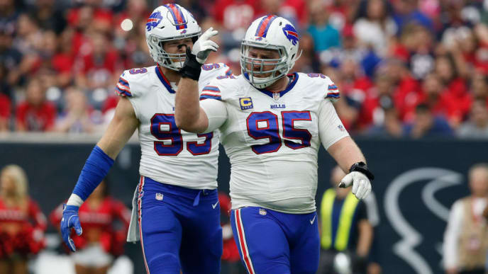 HOUSTON, TX - OCTOBER 14:  Kyle Williams #95 of the Buffalo Bills celebrates after a sack in the first half against the Houston Texans at NRG Stadium on October 14, 2018 in Houston, Texas.  (Photo by Tim Warner/Getty Images)