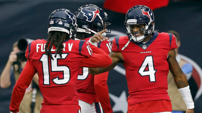 HOUSTON, TX - OCTOBER 14: DeAndre Hopkins #10 of the Houston Texans celebrates with Will Fuller #15 and Deshaun Watson #4 after a touchdown during  a football game against the Buffalo Bills at NRG Stadium on October 14, 2018 in Houston, Texas. (Photo by Bob Levey/Getty Images)