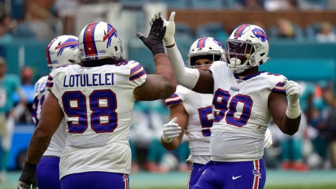 MIAMI, FL - NOVEMBER 17: Star Lotulelei #98 of the Buffalo Bills celebrates with Shaq Lawson #90 after a sack during the third quarter against the Miami Dolphins at Hard Rock Stadium on November 17, 2019 in Miami, Florida. (Photo by Eric Espada/Getty Images)
