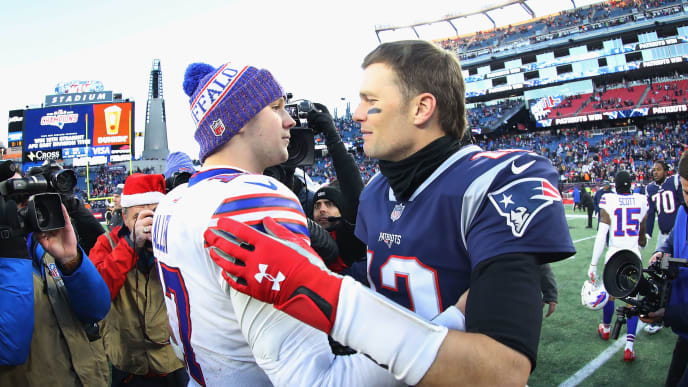 FOXBOROUGH, MA - DECEMBER 23:  Josh Allen #17 of the Buffalo Bills and Tom Brady #12 of the New England Patriots meet on the field after the New England Patriots defeated the Buffalo Bills 24-12 at Gillette Stadium on December 23, 2018 in Foxborough, Massachusetts.  (Photo by Maddie Meyer/Getty Images)