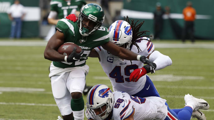EAST RUTHERFORD, NEW JERSEY - SEPTEMBER 08: Jamison Crowder #82 of the New York Jets is tackled by Tremaine Edmunds #49 and Matt Milano #58 of the Buffalo Bills during second quarter the at MetLife Stadium on September 08, 2019 in East Rutherford, New Jersey. (Photo by Michael Owens/Getty Images)