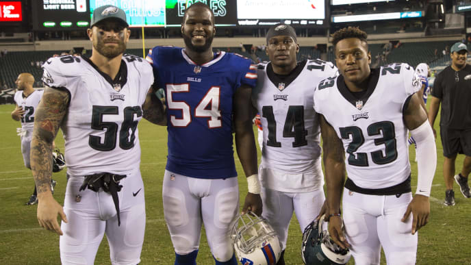 PHILADELPHIA, PA - AUGUST 17: Chris Long #56, David Watford #14, and Rodney McLeod #23 of the Philadelphia Eagles pose for a picture with Max Valles #54 of the Buffalo Bills after the preseason game at Lincoln Financial Field on August 17, 2017 in Philadelphia, Pennsylvania. The Eagles defeated the Bills 20-16. (Photo by Mitchell Leff/Getty Images)