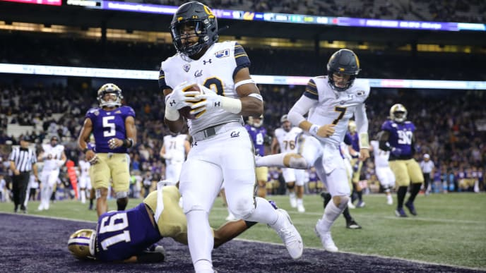 SEATTLE, WASHINGTON - SEPTEMBER 07: Marcel Dancy #23 of the California Golden Bears scores a 20 yard touchdown run against the Washington Huskies in the third quarter during their game at Husky Stadium on September 07, 2019 in Seattle, Washington. (Photo by Abbie Parr/Getty Images)