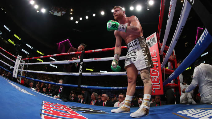 LAS VEGAS, NEVADA - MAY 04:  Canelo Alvarez comes out of his corner during his unanimous decision win over Daniel Jacobs in their middleweight unification fight at T-Mobile Arena on May 04, 2019 in Las Vegas, Nevada. (Photo by Al Bello/Getty Images)