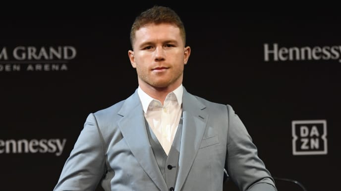 LAS VEGAS, NEVADA - OCTOBER 30:  Boxer Canelo Alvarez holds his belts as he poses during a news conference at the KA Theatre at MGM Grand Hotel & Casino on October 30, 2019 in Las Vegas, Nevada. Alvarez, who is making his debut at light heavyweight, will challenge WBO light heavyweight champion Sergey Kovalev for his title at MGM Grand Garden Arena in Las Vegas on November 2.  (Photo by Ethan Miller/Getty Images)