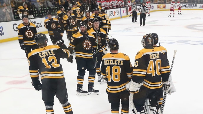 BOSTON, MASSACHUSETTS - MAY 12: The Boston Bruins celebrate their 6-2 victory over the Carolina Hurricanes in Game Two of the Eastern Conference Final during the 2019 NHL Stanley Cup Playoffs at TD Garden on May 12, 2019 in Boston, Massachusetts. (Photo by Bruce Bennett/Getty Images)