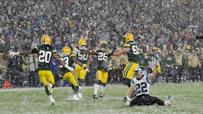 GREEN BAY, WISCONSIN - NOVEMBER 10: Darnell Savage #26 of the Green Bay Packers and teammates celebrate in front of Christian McCaffrey #22 of the Carolina Panthers after getting the stop in the fourth quarter  at Lambeau Field on November 10, 2019 in Green Bay, Wisconsin. (Photo by Quinn Harris/Getty Images)