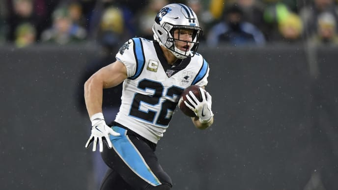 GREEN BAY, WISCONSIN - NOVEMBER 10: Christian McCaffrey #22 of the Carolina Panthers runs with the football against the Green Bay Packers at Lambeau Field on November 10, 2019 in Green Bay, Wisconsin. (Photo by Quinn Harris/Getty Images)