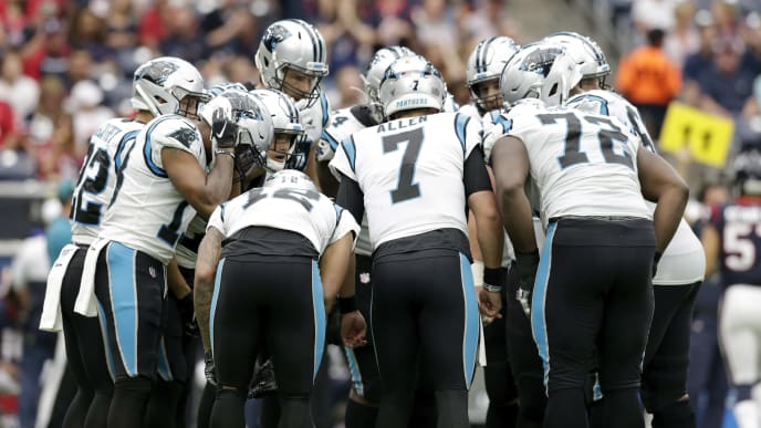 HOUSTON, TX - SEPTEMBER 29:  Kyle Allen #7 of the Carolina Panthers calls a play in the huddle in the first half against the Houston Texans at NRG Stadium on September 29, 2019 in Houston, Texas.  (Photo by Tim Warner/Getty Images)