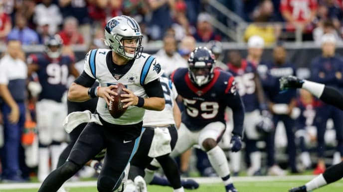 HOUSTON, TX - SEPTEMBER 29:  Kyle Allen #7 of the Carolina Panthers rolls out to pass in the second half against the Houston Texans at NRG Stadium on September 29, 2019 in Houston, Texas.  (Photo by Tim Warner/Getty Images)