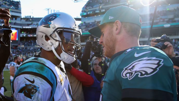 PHILADELPHIA, PA - OCTOBER 21:  Quarterback Carson Wentz #11 (R) of the Philadelphia Eagles congratulates quarterback Cam Newton #1 (L) of the Carolina Panthers on their win at Lincoln Financial Field on October 21, 2018 in Philadelphia, Pennsylvania. The Panthers won 21-17.  (Photo by Brett Carlsen/Getty Images)