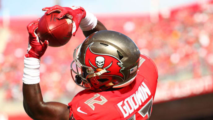 TAMPA, FLORIDA - DECEMBER 02: Chris Godwin #12 of the Tampa Bay Buccaneers catches a touchdown pass thrown by Jameis Winston #3 during the second quarter at Raymond James Stadium on December 02, 2018 in Tampa, Florida. (Photo by Will Vragovic/Getty Images)