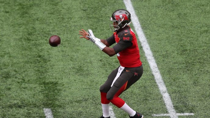 LONDON, ENGLAND - OCTOBER 13: Jameis Winston of Tampa Bay Buccaneers catches the ball during the NFL game between Carolina Panthers and Tampa Bay Buccaneers at Tottenham Hotspur Stadium on October 13, 2019 in London, England. (Photo by Naomi Baker/Getty Images)