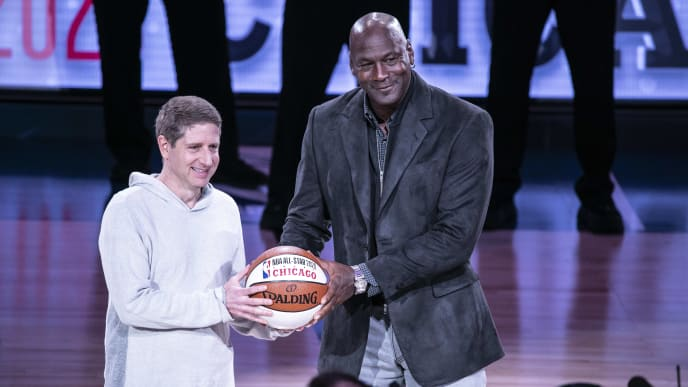 CHARLOTTE, NORTH CAROLINA - FEBRUARY 17: Chicago Bulls President/COO Michael Reinsdorf Jr. (L) accepts the ceremonial All-Star ball from Charlotte Hornets Chairman Michael Jordan at the 68th NBA All-Star Game  on February 17, 2019 in Charlotte, North Carolina. (Photo by Jeff Hahne/Getty Images)