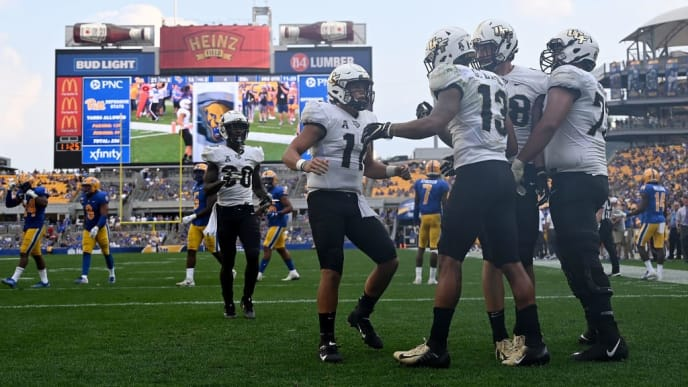 PITTSBURGH, PA - SEPTEMBER 21: Gabriel Davis #13 of the UCF Knights celebrates with Dillon Gabriel #11 after 10-yard touchdown reception in the third quarter during the game against the Pittsburgh Panthers at Heinz Field on September 21, 2019 in Pittsburgh, Pennsylvania. (Photo by Justin Berl/Getty Images)