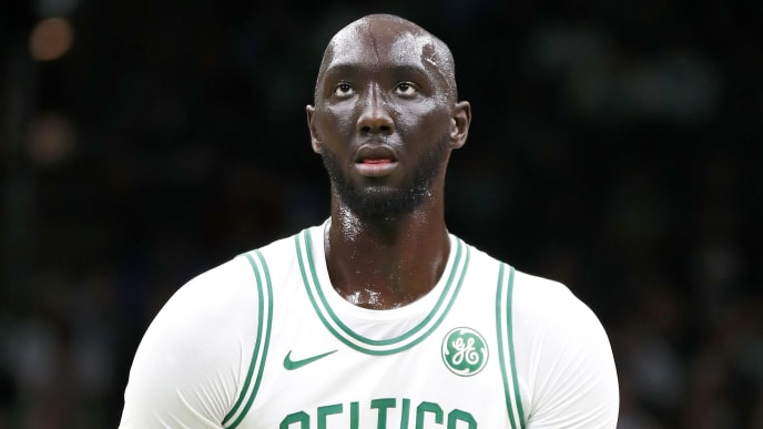 BOSTON, MASSACHUSETTS - OCTOBER 06: Tacko Fall shoots a free throw during the fourth quarter of the game against the Charlotte Hornets at TD Garden on October 06, 2019 in Boston, Massachusetts. NOTE TO USER: User expressly acknowledges and agrees that, by downloading and or using this photograph, User is consenting to the terms and conditions of the Getty Images License Agreement. (Photo by Omar Rawlings/Getty Images)