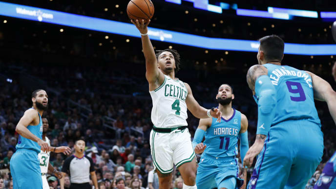 BOSTON, MASSACHUSETTS - OCTOBER 06:  Carson Edwards #4 of the Boston Celtics drives to the basket during the third quarter of the game against the Charlotte Hornets at TD Garden on October 06, 2019 in Boston, Massachusetts. NOTE TO USER: User expressly acknowledges and agrees that, by downloading and or using this photograph, User is consenting to the terms and conditions of the Getty Images License Agreement. (Photo by Omar Rawlings/Getty Images)