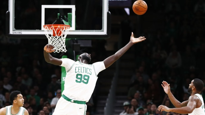BOSTON, MASSACHUSETTS - OCTOBER 06: Tacko Fall #99 of the Boston Celtics rebounds during the fourth quarter of the game against the Charlotte Hornets at TD Garden on October 06, 2019 in Boston, Massachusetts. NOTE TO USER: User expressly acknowledges and agrees that, by downloading and or using this photograph, User is consenting to the terms and conditions of the Getty Images License Agreement. (Photo by Omar Rawlings/Getty Images)