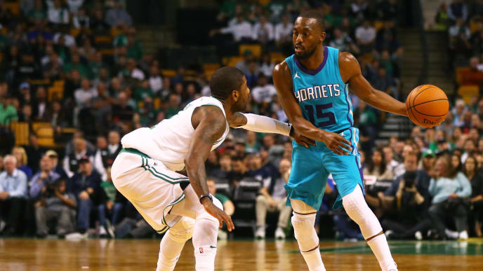 BOSTON, MA - OCTOBER 2: Kyrie Irving #11 of the Boston Celtics defends Kemba Walker #15 of the Charlotte Hornets during the first half at TD Garden on October 2, 2017 in Boston, Massachusetts. NOTE TO USER: User expressly acknowledges and agrees that, by downloading and or using this Photograph, user is consenting to the terms and conditions of the Getty Images License Agreement. (Photo by Maddie Meyer/Getty Images)