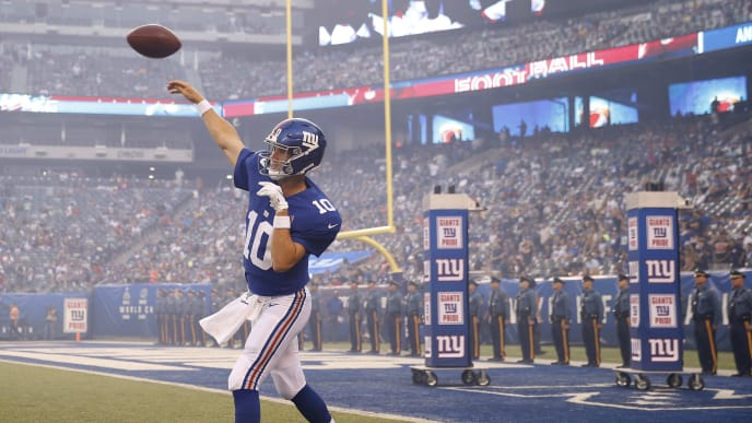 EAST RUTHERFORD, NEW JERSEY - AUGUST 16: Eli Manning #10 of the New York Giants warms up before the game against the Chicago Bears during a preseason game at MetLife Stadium on August 16, 2019 in East Rutherford, New Jersey. (Photo by Elsa/Getty Images)