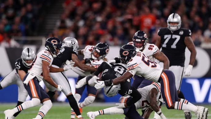 LONDON, ENGLAND - OCTOBER 06: Josh Jacobs of Oakland Raiders is tackled by Roquan Smith of Chicago Bears after rushing the ball during the game between Chicago Bears and Oakland Raiders at Tottenham Hotspur Stadium on October 06, 2019 in London, England. (Photo by Naomi Baker/Getty Images)
