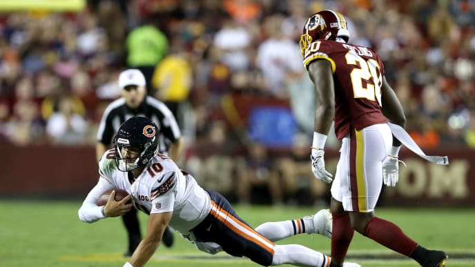 LANDOVER, MARYLAND - SEPTEMBER 23:  Mitchell Trubisky #10 of the Chicago Bears dives forward for extra yards against Landon Collins #20 of the Washington Redskins during the first half in the game at FedExField on September 23, 2019 in Landover, Maryland. (Photo by Rob Carr/Getty Images)