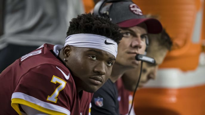 LANDOVER, MD - SEPTEMBER 23: Dwayne Haskins #7 of the Washington Redskins looks on while sitting on the bench next to offensive coordinator Kevin OConnell and Case Keenum #8 against the Chicago Bears during the second half at FedExField on September 23, 2019 in Landover, Maryland. (Photo by Scott Taetsch/Getty Images)