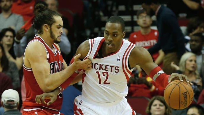 HOUSTON, TX - DECEMBER 18:   Dwight Howard #12 of the Houston Rockets is grabbed unber the basket by Joakim Noah #13 of the Chicago Bulls during the game at Toyota Center on December 18, 2013 in Houston, Texas. NOTE TO USER: User expressly acknowledges and agrees that, by downloading and or using this photograph, User is consenting to the terms and conditions of the Getty Images License Agreement. (Photo by Scott Halleran/Getty Images)