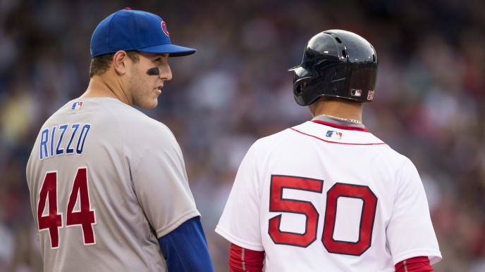 BOSTON, MA - APRIL 29:   Anthony Rizzo #44 of the Chicago Cubs talks to Mookie Betts #50 of the Boson Red Sox in the eighth inning at Fenway Park on April 29, 2017 in Boston, Massachusetts. (Photo by Michael Ivins/Boston Red Sox/Getty Images)