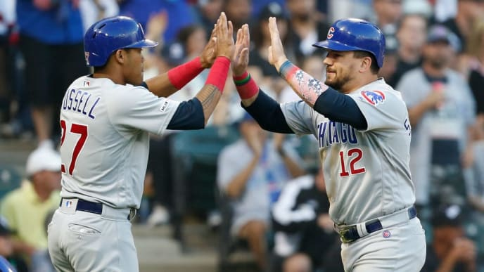 CHICAGO, ILLINOIS - JULY 06: Addison Russell #27 of the Chicago Cubs and Kyle Schwarber #12 after they scored during the fifth inning against the Chicago White Sox at Guaranteed Rate Field on July 06, 2019 in Chicago, Illinois. (Photo by Nuccio DiNuzzo/Getty Images)