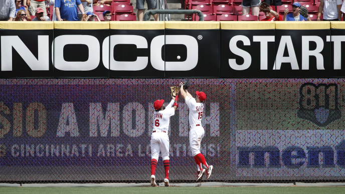 CINCINNATI, OH - AUGUST 11: Phillip Ervin #6 and Nick Senzel #15 of the Cincinnati Reds try to play the ball off the wall after a double by Ian Happ of the Chicago Cubs in the seventh inning at Great American Ball Park on August 11, 2019 in Cincinnati, Ohio. The Cubs defeated the Reds 6-3. (Photo by Joe Robbins/Getty Images)