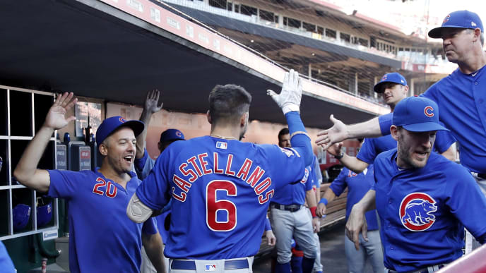 CINCINNATI, OH - AUGUST 09: Nicholas Castellanos #6 of the Chicago Cubs celebrates in the dugout after hitting a solo home run in the first inning against the Cincinnati Reds at Great American Ball Park on August 9, 2019 in Cincinnati, Ohio. (Photo by Joe Robbins/Getty Images)