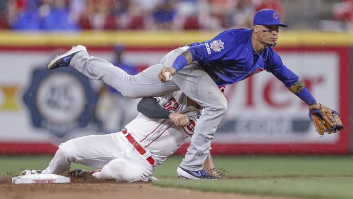CINCINNATI, OH - AUGUST 08: Kyle Farmer #52 of the Cincinnati Reds breaks up the double play as Javier Baez of the Chicago Cubs #9 doesn't get the throw off at Great American Ball Park on August 8, 2019 in Cincinnati, Ohio. (Photo by Michael Hickey/Getty Images)
