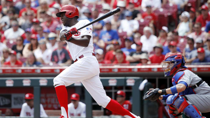 CINCINNATI, OH - AUGUST 11: Aristides Aquino #44 of the Cincinnati Reds hits a single to center field to drive in a run against the Chicago Cubs in the third inning at Great American Ball Park on August 11, 2019 in Cincinnati, Ohio. (Photo by Joe Robbins/Getty Images)