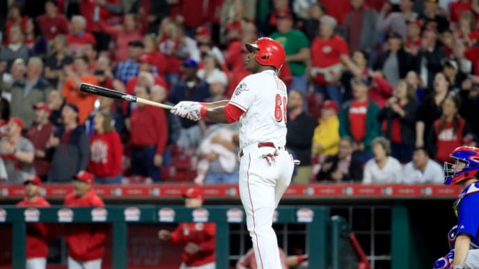 CINCINNATI, OHIO - MAY 15:  Yasiel Puig #66 of the Cincinnati Reds hits a game winning single in the 10th inning against the Chicago Cubs at Great American Ball Park on May 15, 2019 in Cincinnati, Ohio. (Photo by Andy Lyons/Getty Images)