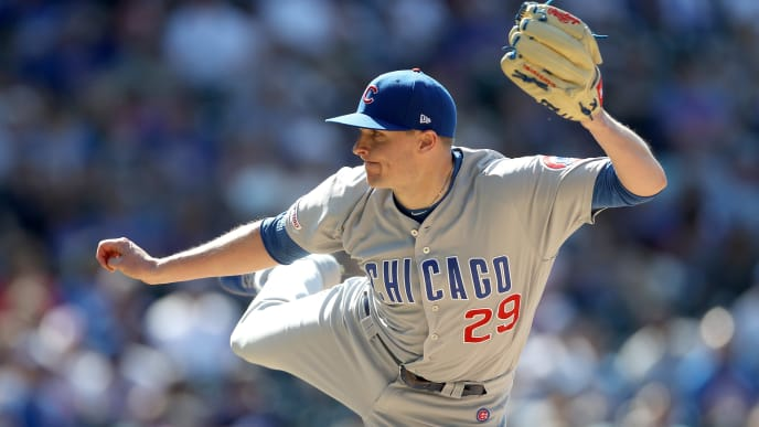 DENVER, COLORADO - JUNE 12: Pitcher Brad Brach #29 of the Chicago Cubs throws in the ninth inning against the Colorado Rockies at Coors Field on June 12, 2019 in Denver, Colorado. (Photo by Matthew Stockman/Getty Images)