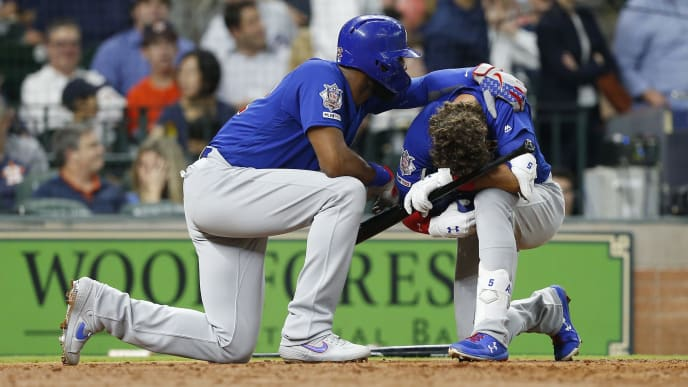 A devastated Albert Almora Jr. after striking a young fan with a foul ball against the Astros.
